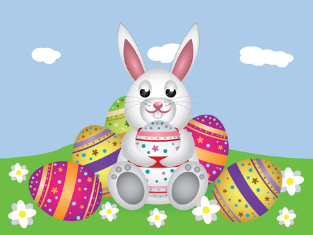 Cute small white lovely bunny with colorful Easter eggs.