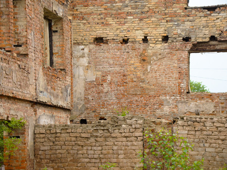 Old destroyed an abandoned house with brick walls. photo