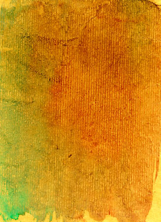 Empty grunge paper texture of red, green and yellow color as background. Stock Photo