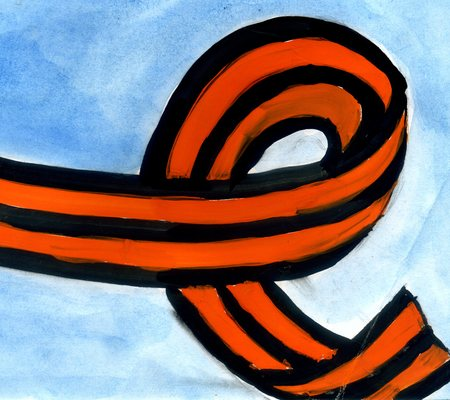 Gouache painted St. George ribbon over blue background. photo