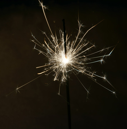 glow pyrotechnics: Bright christmas sparkler, bengal fire burning in the night. Stock Photo