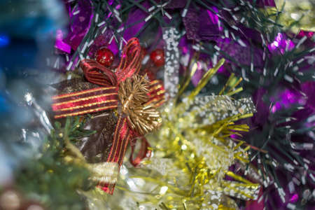 Colored decorative Christmas tinsel texture as holiday background. photo