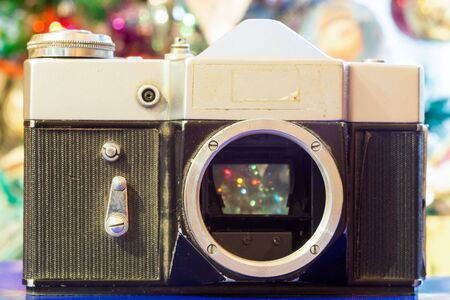 lense: Christmas decorations background with retro camera without lense. Stock Photo