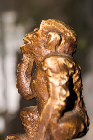 statuette: Macro of small wooden statuette of monkey. Stock Photo