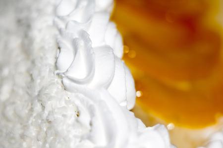 vanilla cake: Tasty vanilla cake with fruits and cream decorations, macro photo. Stock Photo