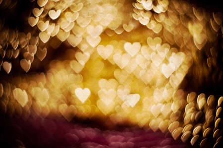 gold textured background: Colorful blurred background of pink and gold color, bokeh effects, textured with paper.