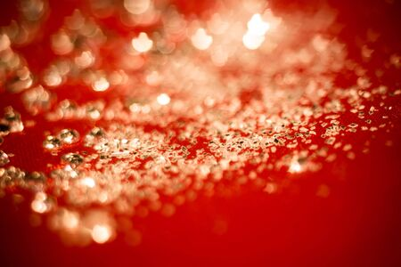 Big silver glitters on pink background, macro with shallow focus, bokeh effect. Stock Photo