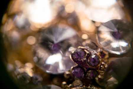 extremely: Diamonds in different sizes, golden jewelry extremely close up background.