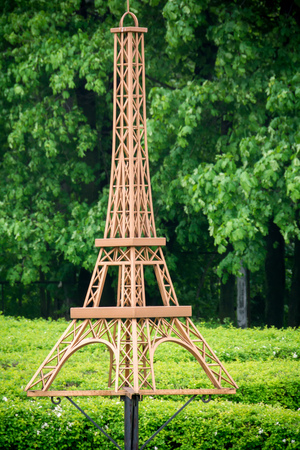 retort: Decorative fake Eiffel tower of brown color in the park. Stock Photo