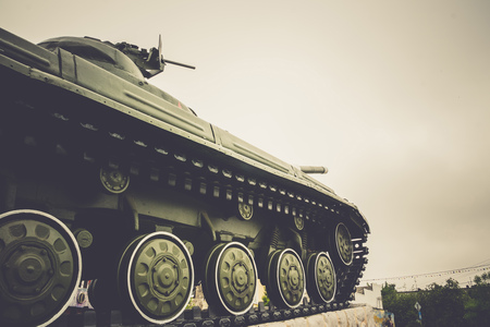 Vintage military tank in the city, close up background.