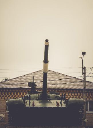 ready for war: Vintage military tank in the city, close up background.