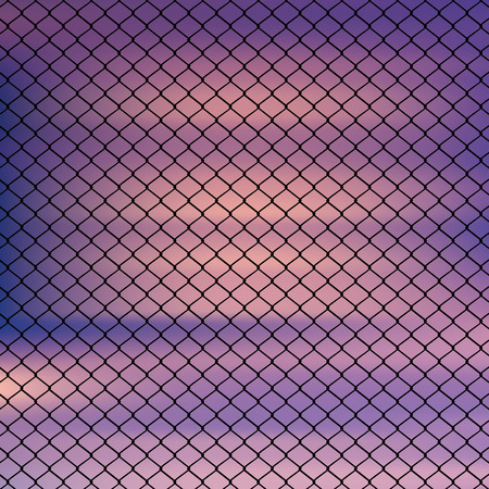 wired: Metal wired fence against blurry sky background.