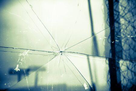 splinters: Sharp glass hole cracks splinters, broken glass by the street, retro colors.