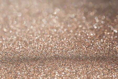 Decorative brown glitter texture macro, defocused background, bokeh.