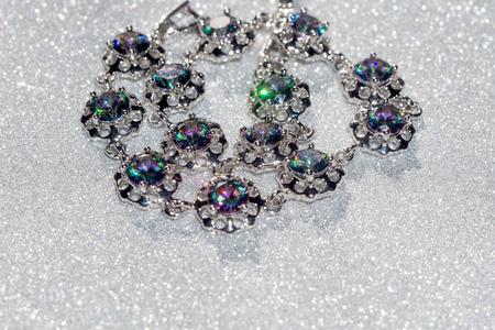 topaz: Fashion bracelet with mystic topaz, rainbow topaz on glittering background.