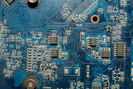 electric circuit: Blue electric circuit board, close up background.