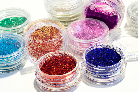 gold cans: Collection of nail glitters of different colors, close up. Stock Photo