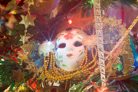 Carnival mask with feathers on a background of holiday lights.