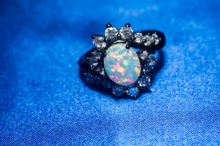 ring of fire: Fashion ring decorated with white fire opal stones. Stock Photo