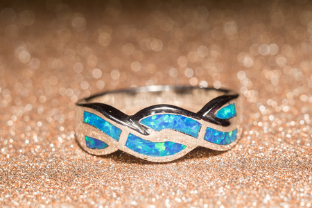 ring of fire: Fashion ring decorated with blue fire opal stones. Stock Photo