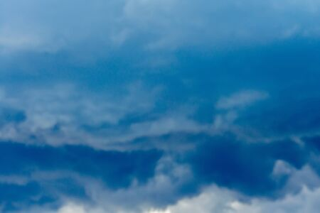 Dramatic stormy dark sky clouds before rain, natural background. Stock Photo