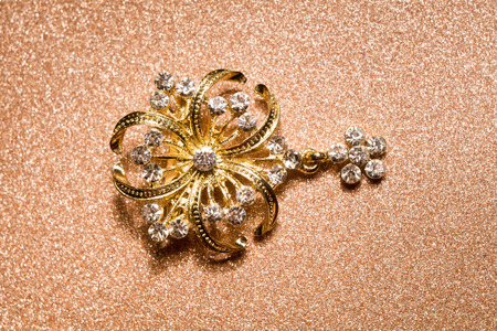 Brooch in a shape of a flower decorated with rhinestones, fashion jewellery.