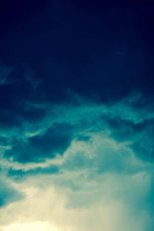 Dramatic stormy black sky clouds before rain, filtered natural background. 版權商用圖片