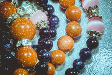 yogini: Fashion bracelets made of blue and gold sandstones, aventurine beads. Stock Photo