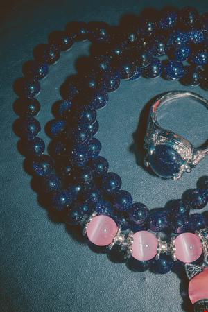 yogini: Fashion bracelet made of blue sand stone, aventurine with pink opal beads. Stock Photo