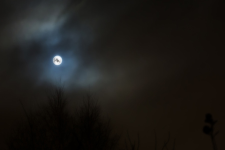 lonesome: Photo of dark night cloudy sky and moon, defocused background. Stock Photo