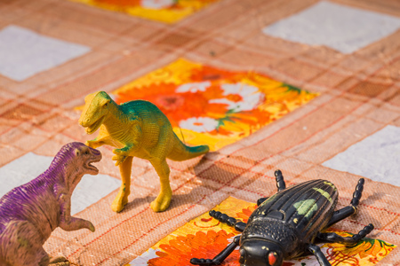 Plastic toys of prehistoric animals, dinosaur on the table. Stock Photo