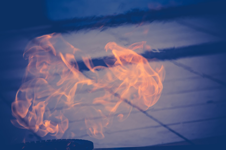 Open flame brightly burning in the street.