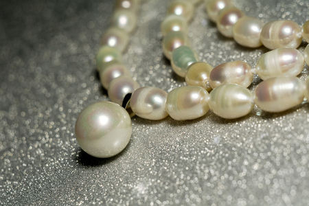 41406611dc0c02 Natural white freshwater pearl necklace close up background.