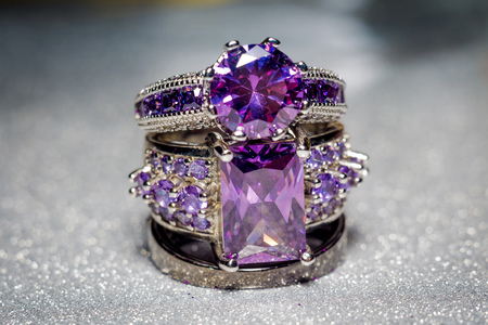 Fashion silver ring with purple zirconia, amethyst imitation. Stock Photo