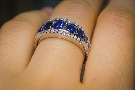 Fashion silver ring with blue purple tanzanite gem.