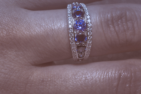 Fashion silver ring with blue purple tanzanite gem, filtered. Stock Photo