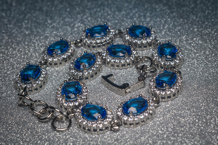 Fashion silver bracelet with blue violet stone, tanzanite imitation.