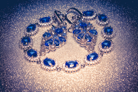 Fashion silver bracelet and earrings with blue violet stone, tanzanite imitation. Stock Photo