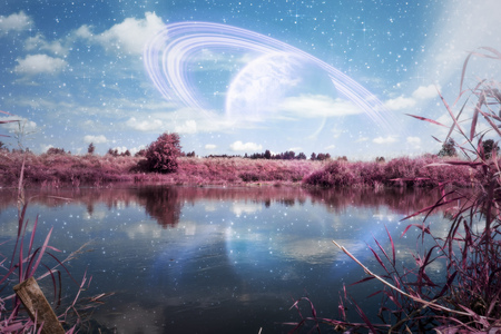 Summer forest near river landscape with big planet in the sky, photo manipulation, edited colors. 版權商用圖片 - 107202633
