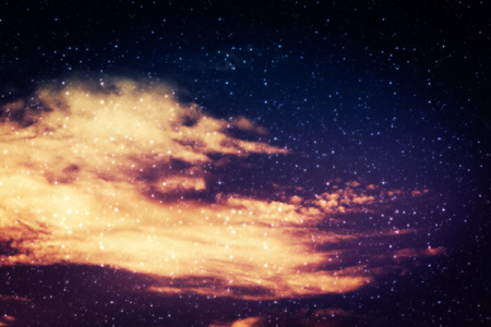 Sky background with clouds and stars, flares effect used, edited photo.