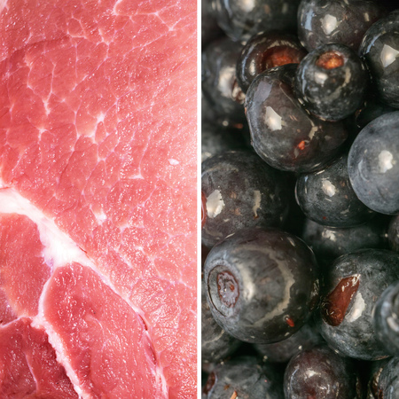 Macro of raw pork slice and fresh blueberries, diet, healthy food themed background.