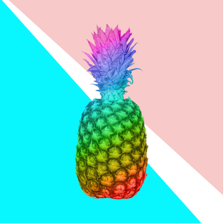 Fresh delicious pineapple, rainbow toned on pink background.