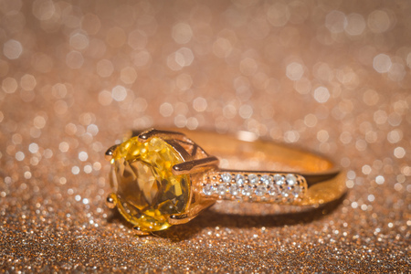 Yellow gold ring with shining citrine gemstone.