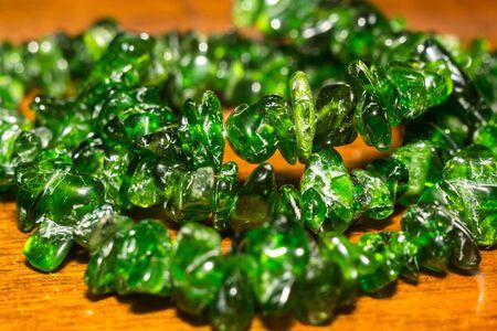 Dark green chrome diopside gravel, natural stone close up.