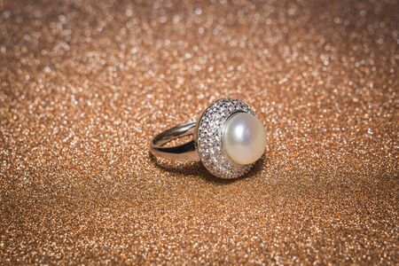 Luxury silver ring decorated with freshwater pearl of white color and diamonds.