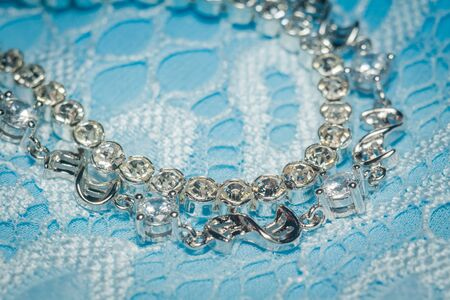 Fashion silver bracelet with white cubic zirconia on blue lace