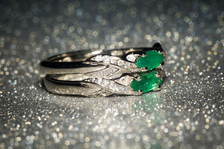 Fashion silver ring decorated with natural emerald stone.