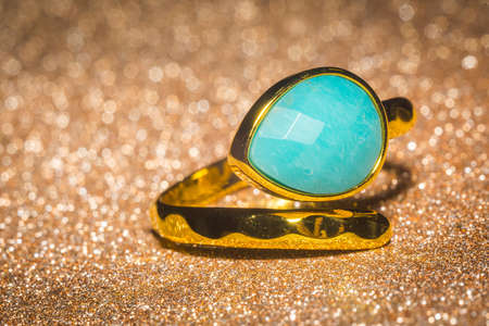 Fashion yellow gold ring with a blue-green amazonite stone.