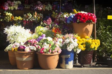 flower shop: Artificial flower shop in the market.