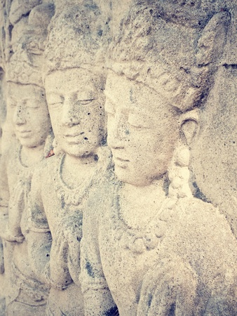 dhamma: Stone carving by hand  Portrait of three people wearing crown Stock Photo